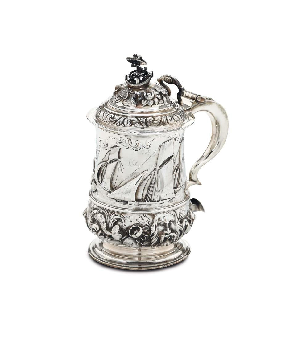 A tankard in molten, embossed and chiselled silver,