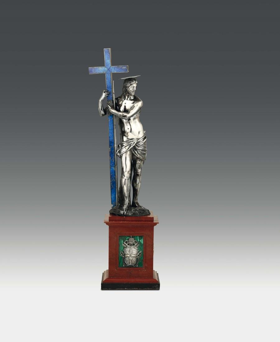 A silver sculpture depicting Christ on the cross in