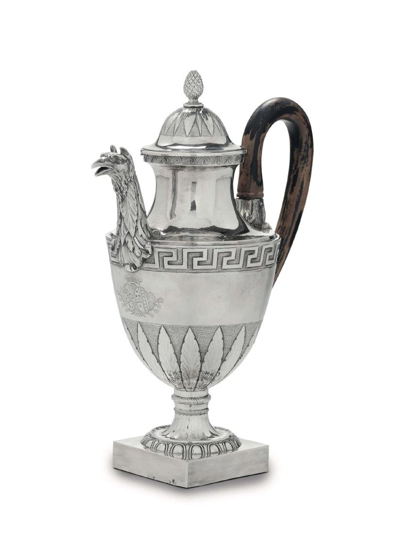 A coffee pot in embossed, chiselled and engraved silver