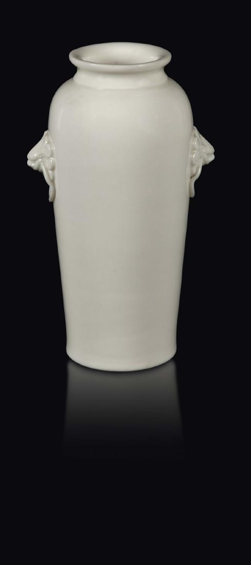A Blanc de Chine Dehua vase with mask handles, China,