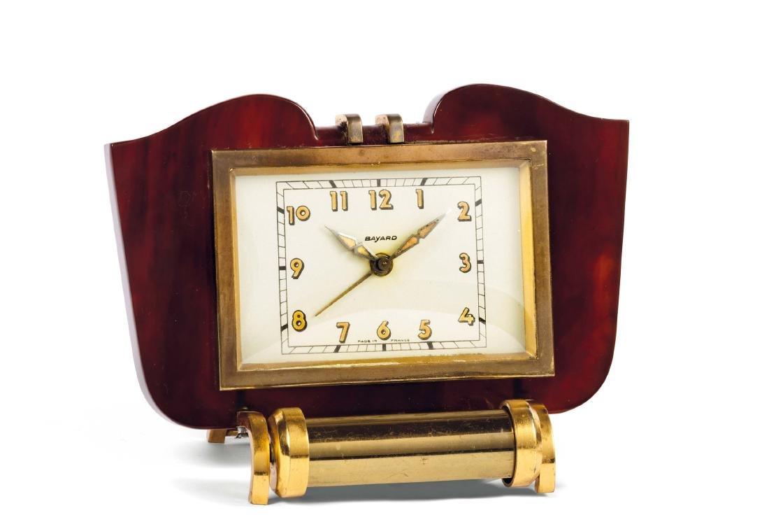 BAYARD, gilt brass and bakelite desk clock with lamp.