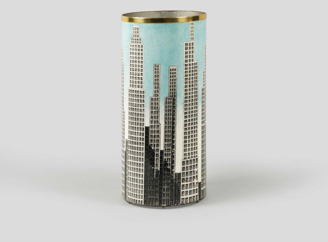 Fornasetti, Milan, 1980s. A cylindric metal umbrella