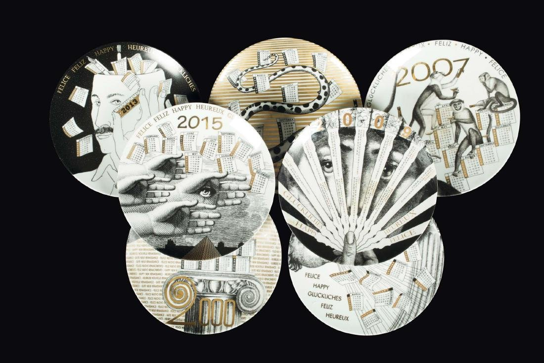 Fornasetti, Milano, 1990s. Seven plates from the