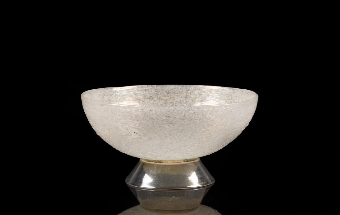 Murano, 1930 ca. A glass cup with a strongly iridised