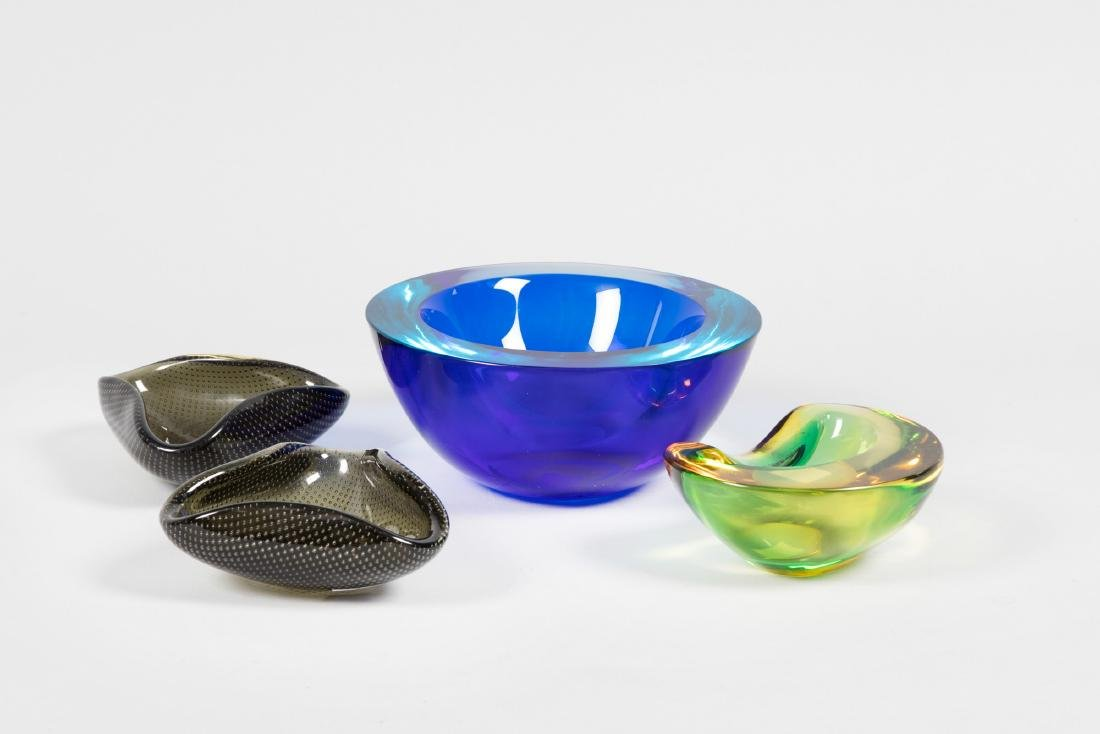 A lot made up by four glass ashtrays
