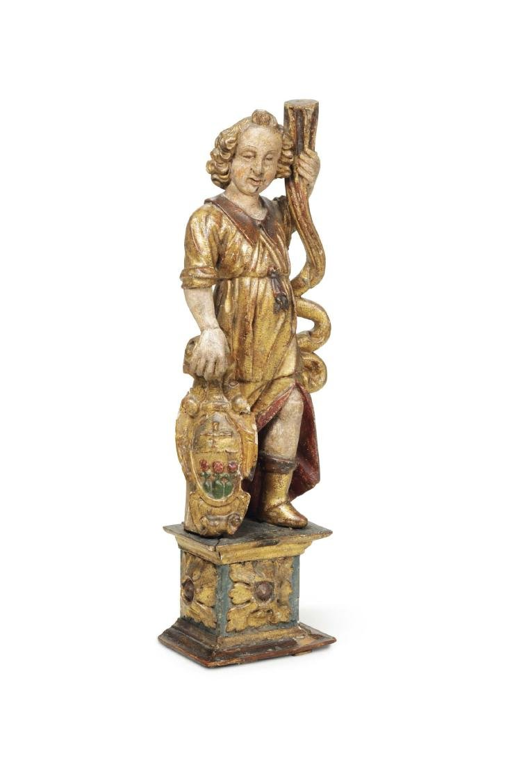An angel torch holder in polychrome and gilt wood,
