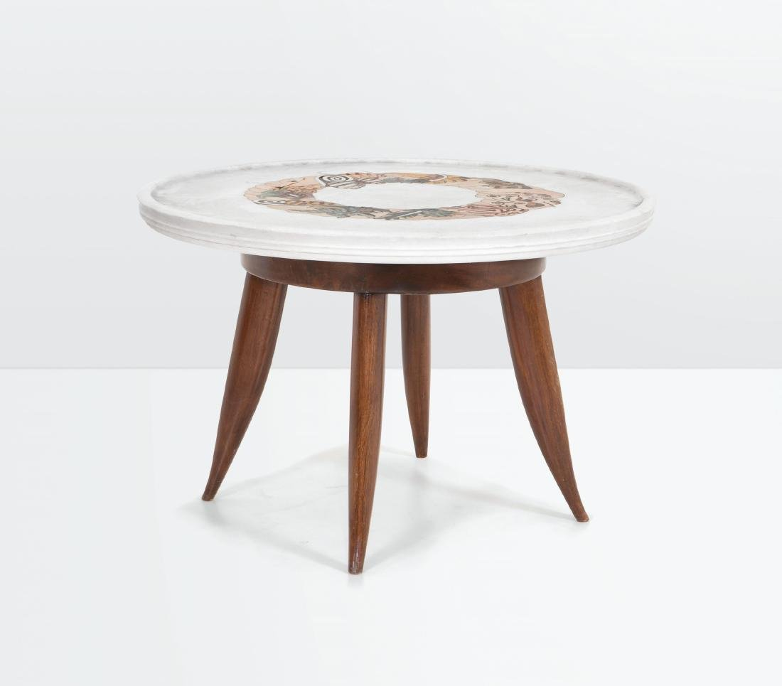 Kovach, a low table with a wooden structure and marble
