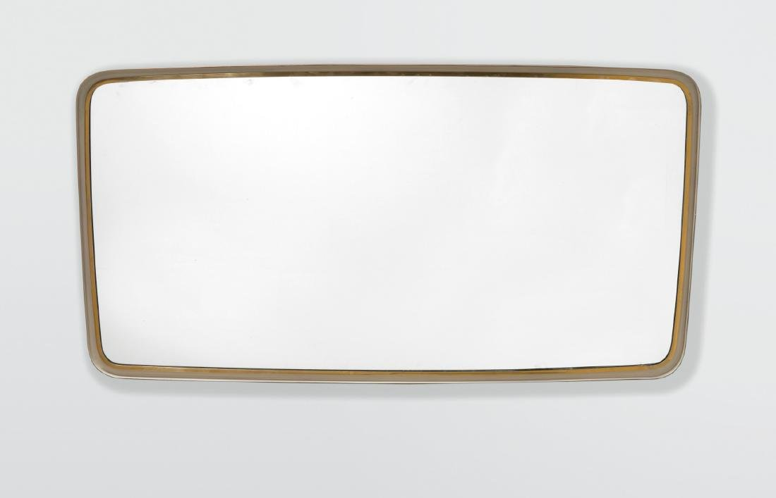 A mirror with a brass frame. Italy, 1950 ca.