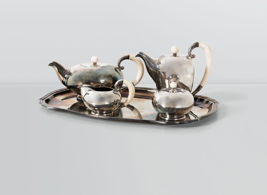 A silver tea set made up by a teapot, a coffee pot, a