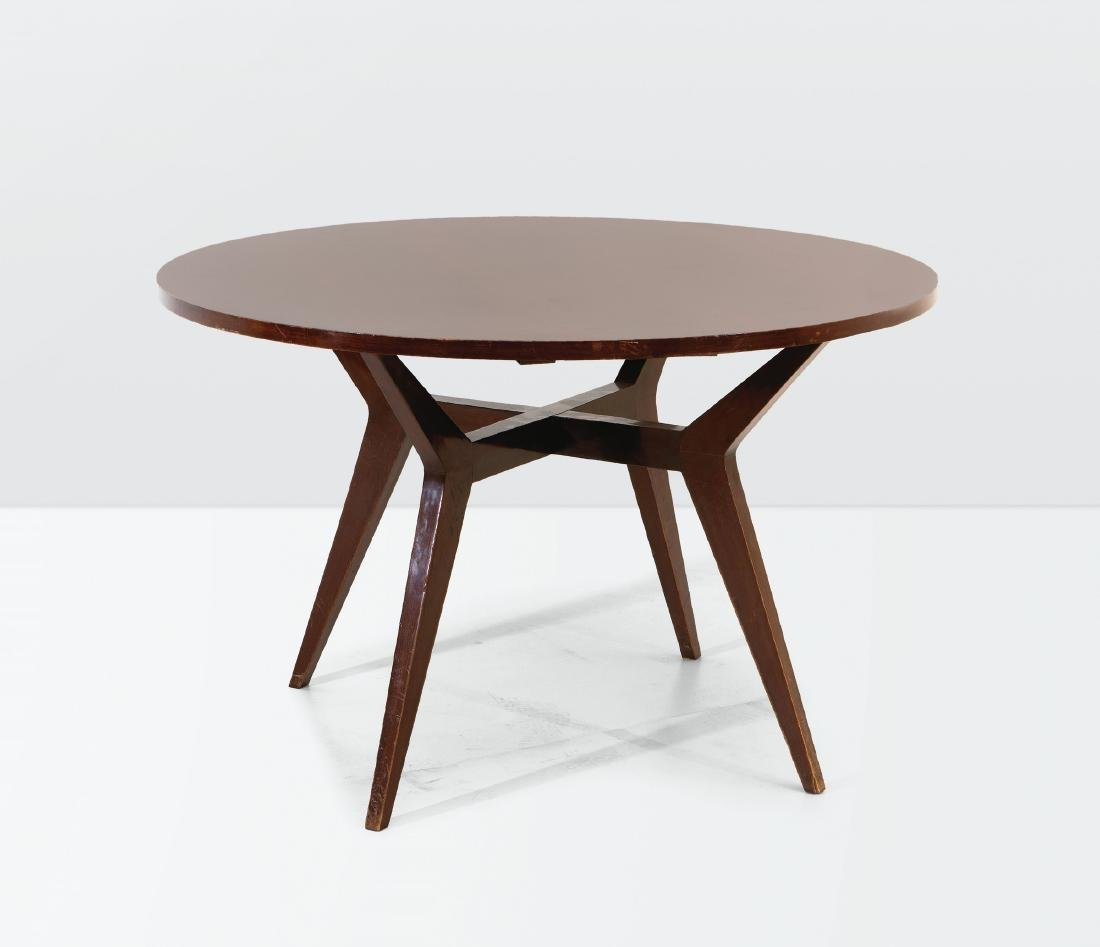 Augusto Romano, a table with a wooden structure and