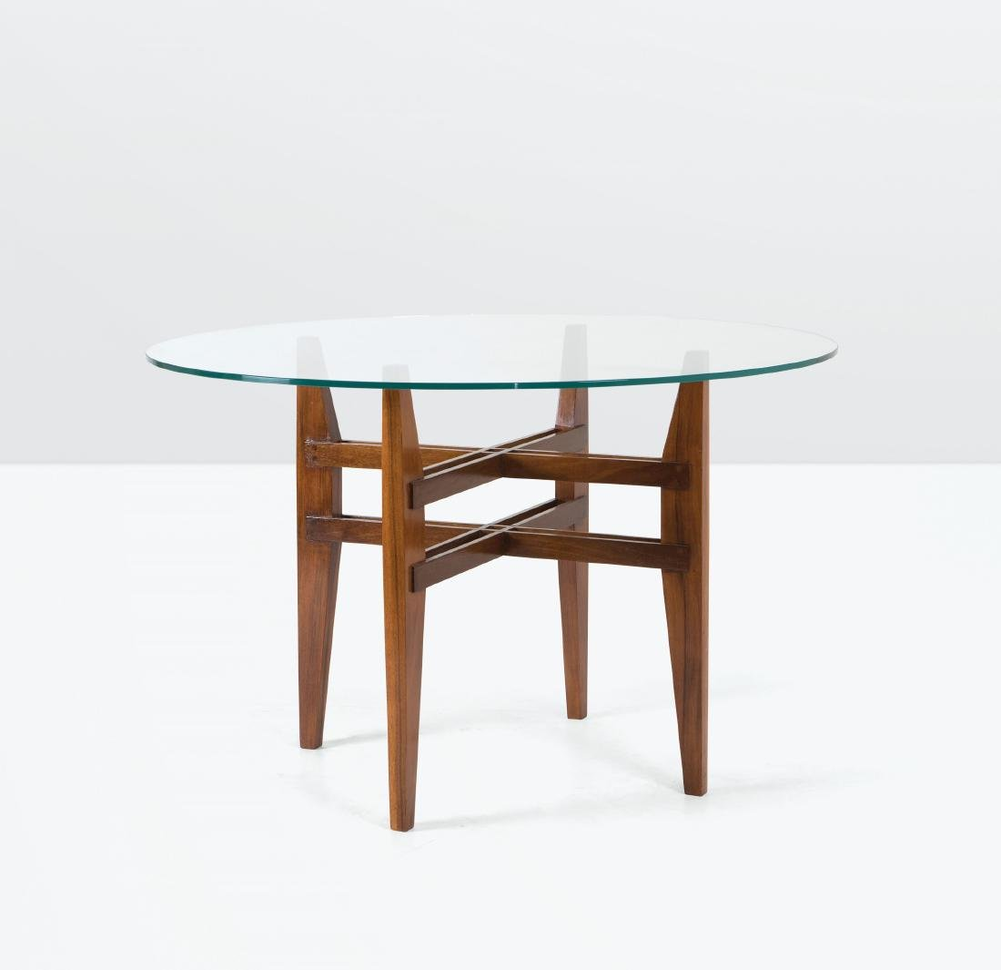 A table with a wooden structure and glass top. Italy,