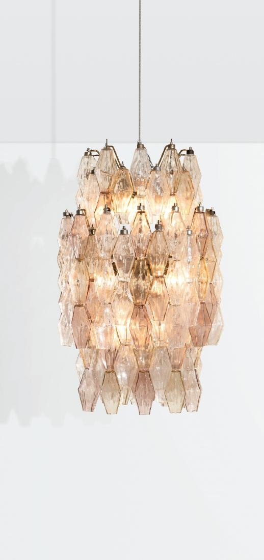 Venini, a ceiling lamp with a metal structure and