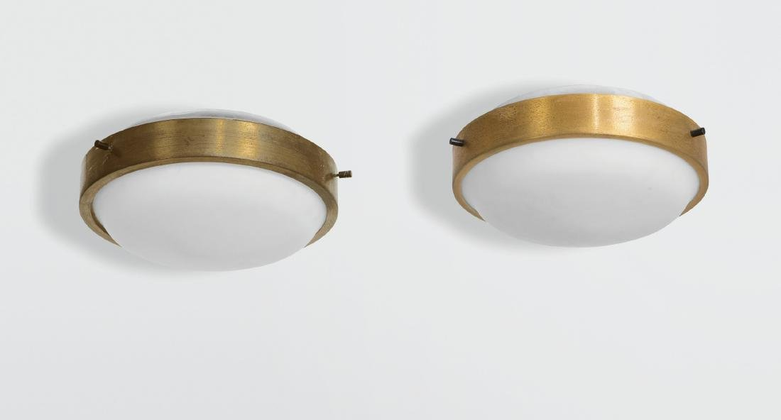 Oscar Torlasco, a pair of plafond lights with a brass
