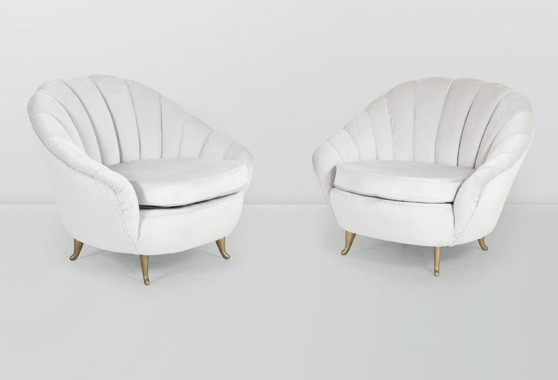 ISA, a pair of armchairs with a wooden structure and