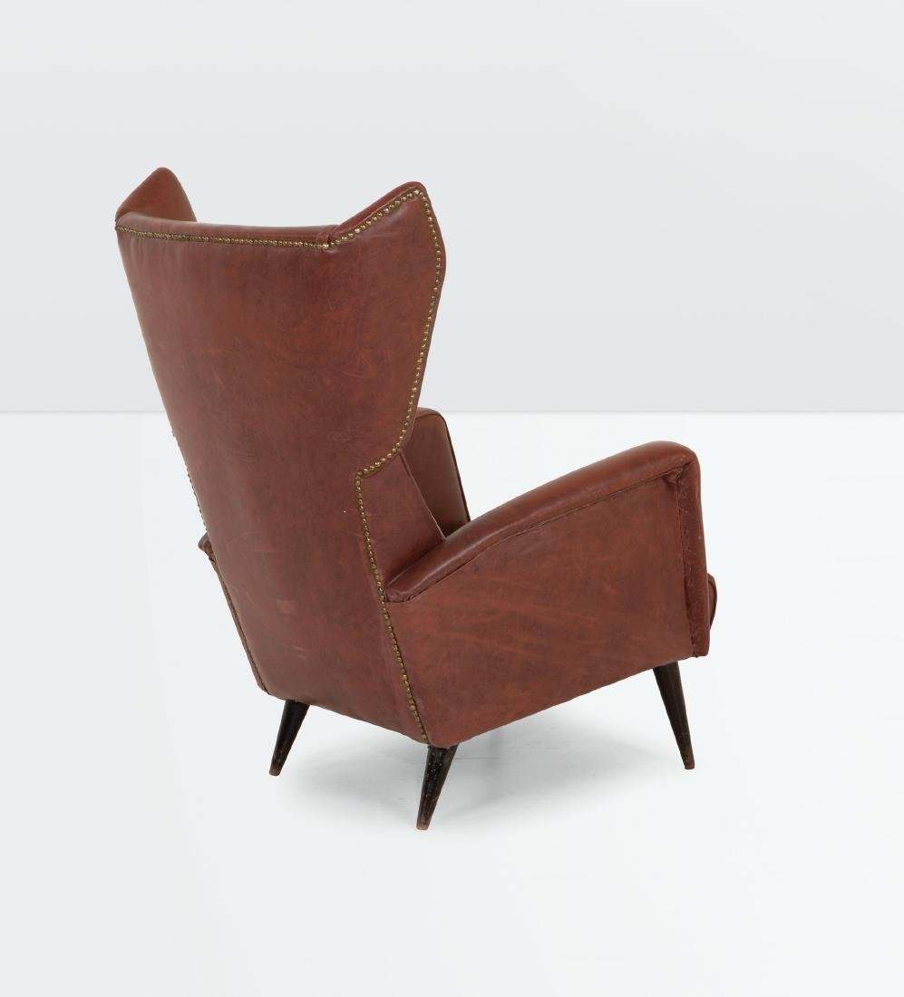 Gio Ponti, an armchair with a wooden structure and skai