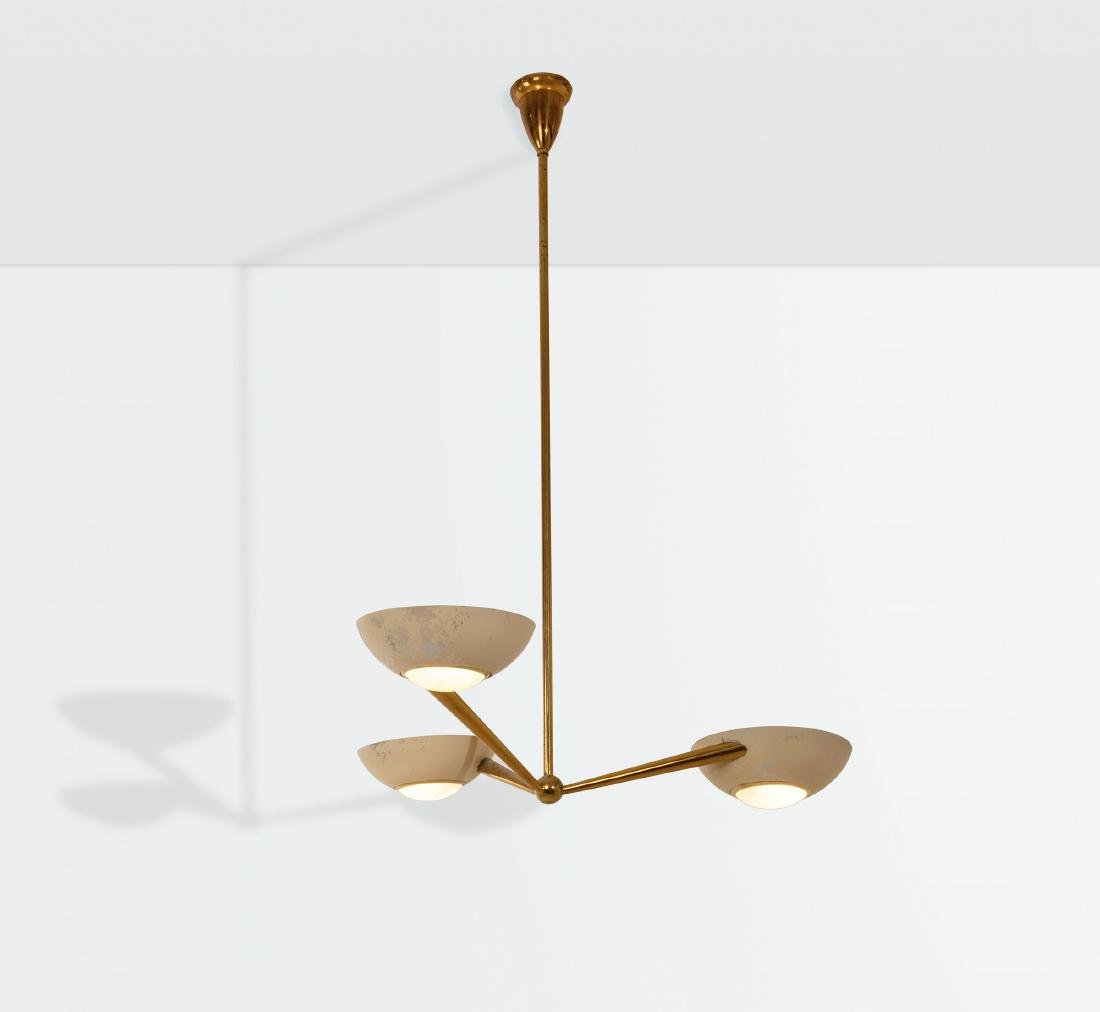 Lumen, a lamp with a brass and lacquered aluminum