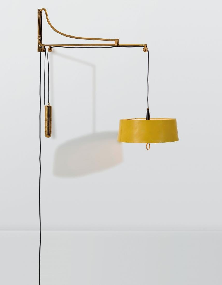 Oscar Torlasco, a wall lamp with an extendable brass