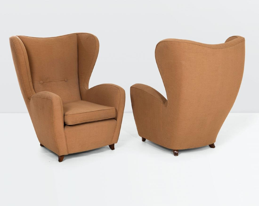 A pair of armchairs with a wooden structure and fabric