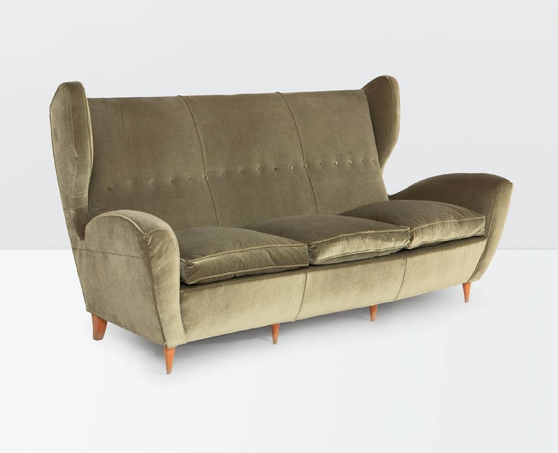 Melchiorre Bega, a sofa with a wooden structure and