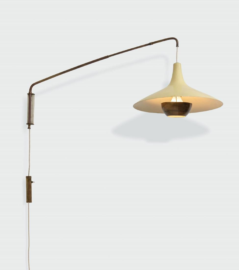 Stilnovo, an extendable wall lamp with a lacquered