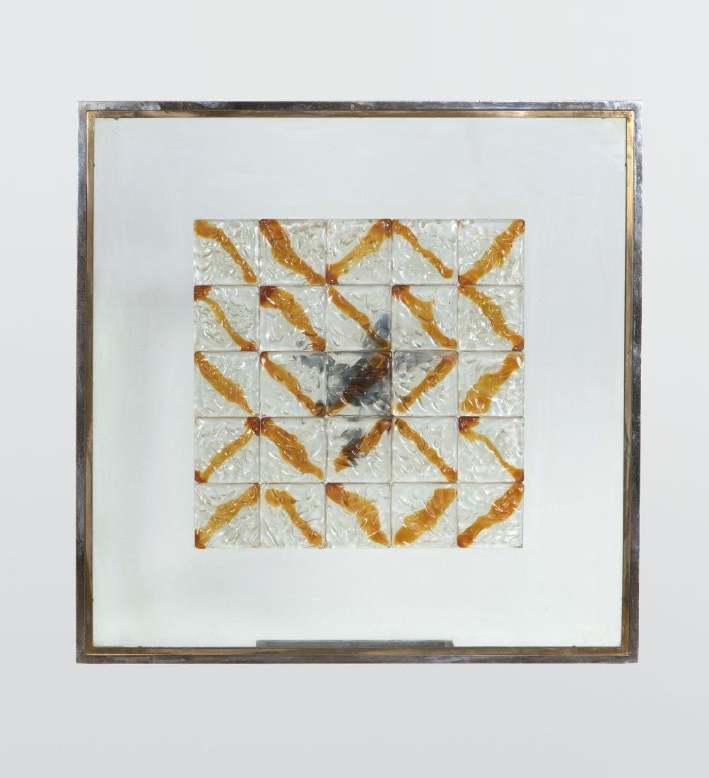 Poliarte, a wall panel with a steel, brass and glass