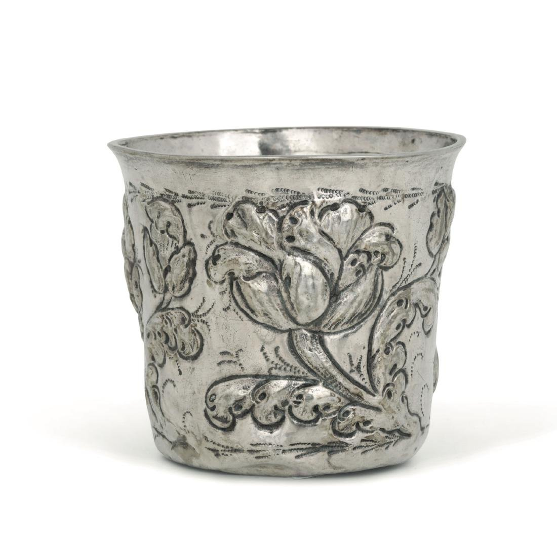 A glass in embossed and chiselled silver with floral