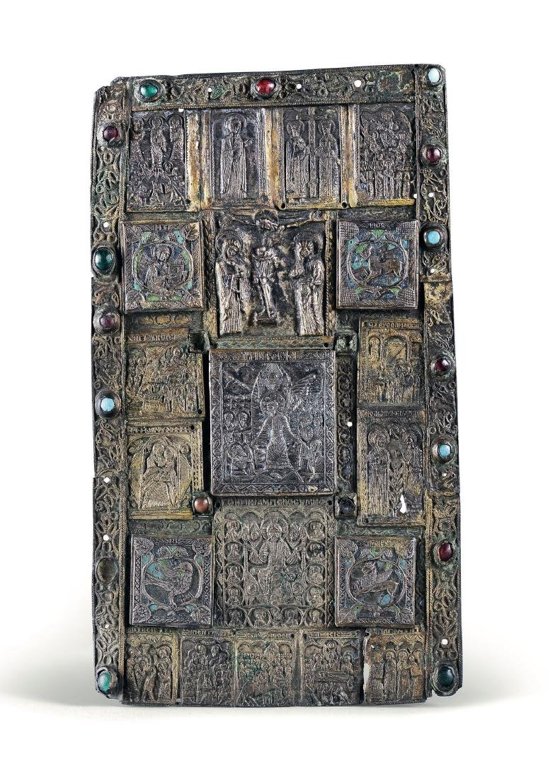 A bronze bible cover with semiprecious stones
