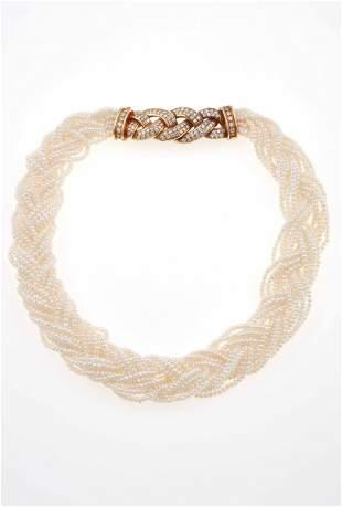 Girocollo a più fili intrecciati con piccole perle