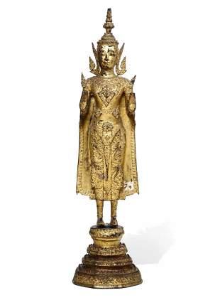 Antica scultura raffigurante divinità in bronzo dorato