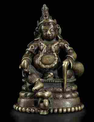 Figura di Sita-Jambhala seduto su fiore di loto in