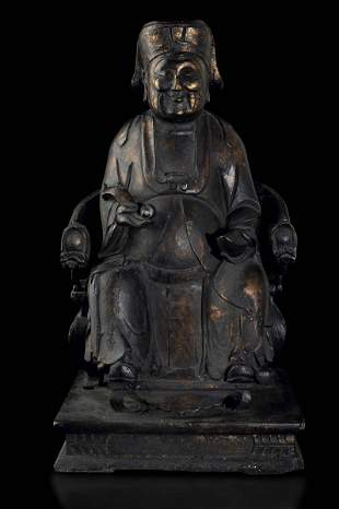 A carved wood figure, China, Ming Dynasty