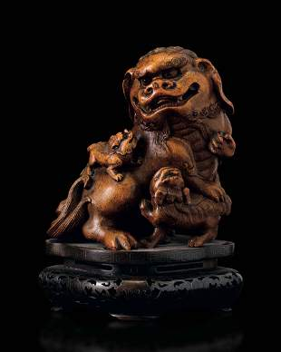 A carved wood group, China, Qing Dynasty