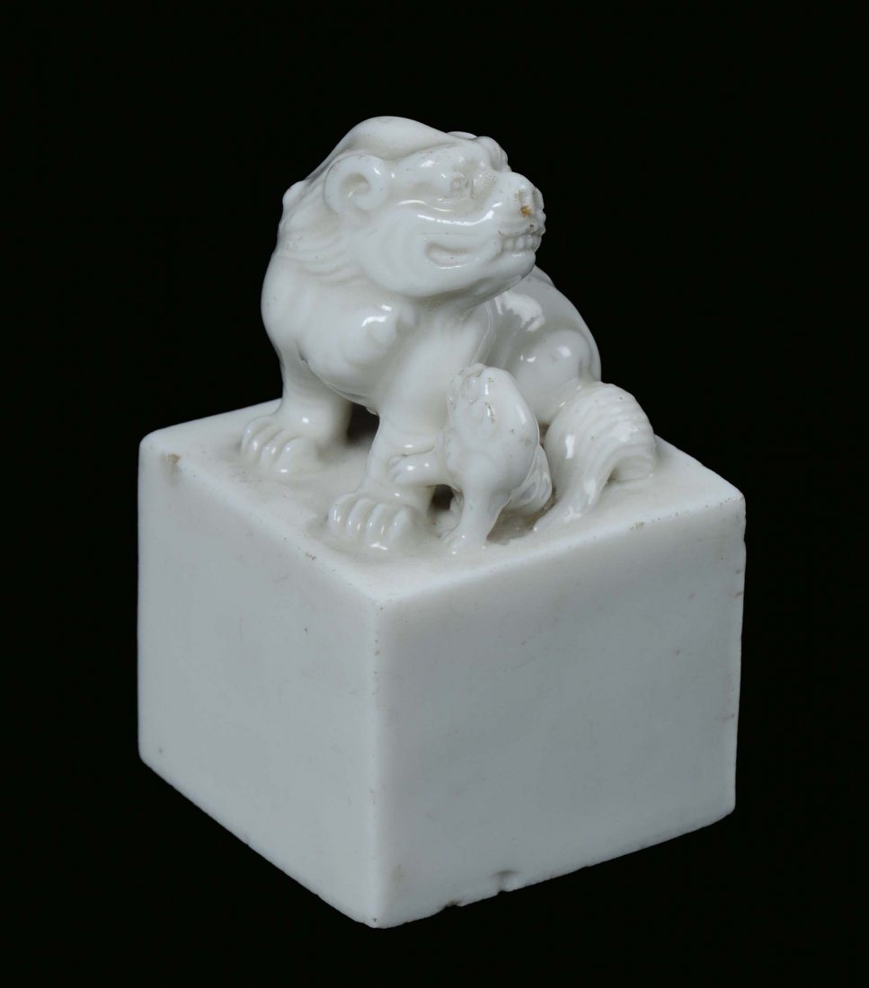 A Blanc de Chine porcelain seal with Pho dog and puppet