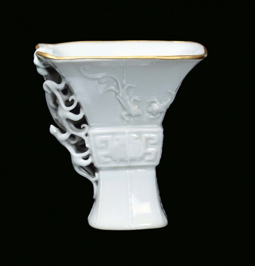 A small white porcelain vase and gold rim, China, Qing