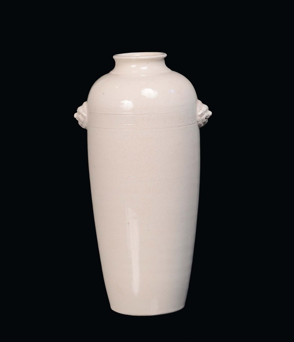 A Blanc de Chine porcelain vase decorated with relief h