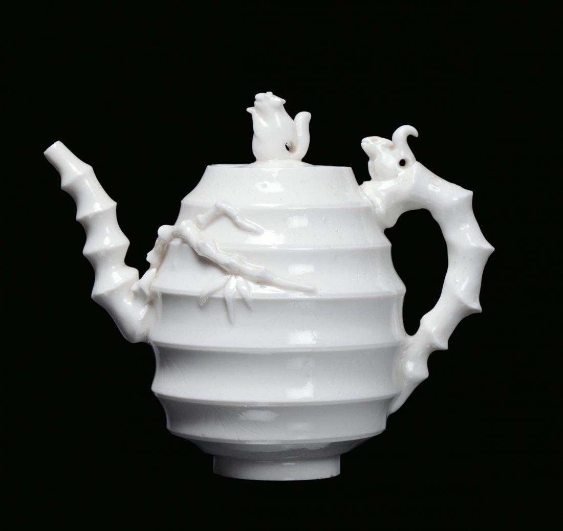 A rare Blanc de Chine porcelain teapot decorated with s