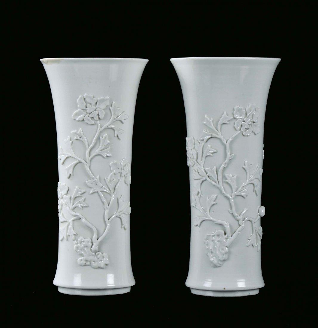 Pair of Blanc de Chine porcelain trumpet vase with reli