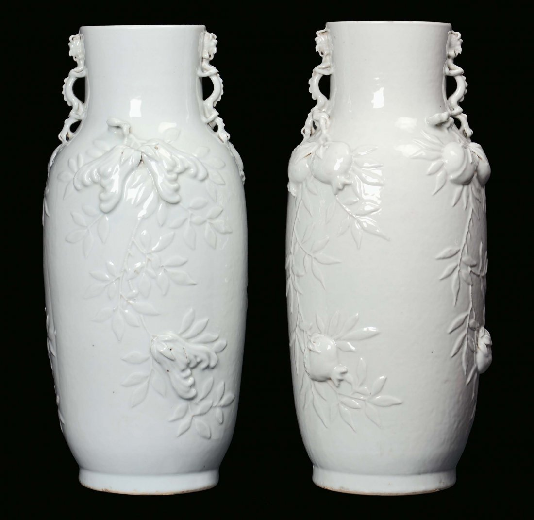 A pair of Blanc de Chine porcelain vases decorated with