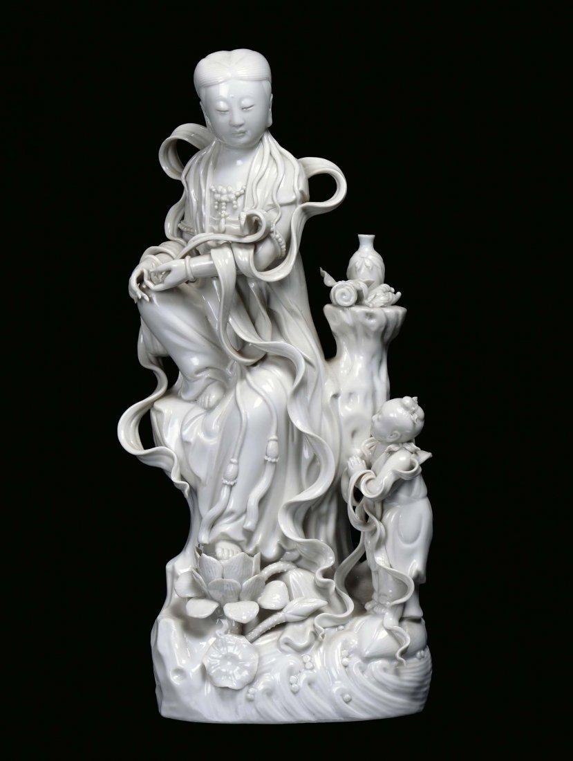 A Blanc de Chine porcelain Guanyin with child, China, 2