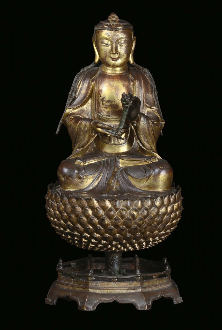 A large and important gilt bronze figure of Buddha on a
