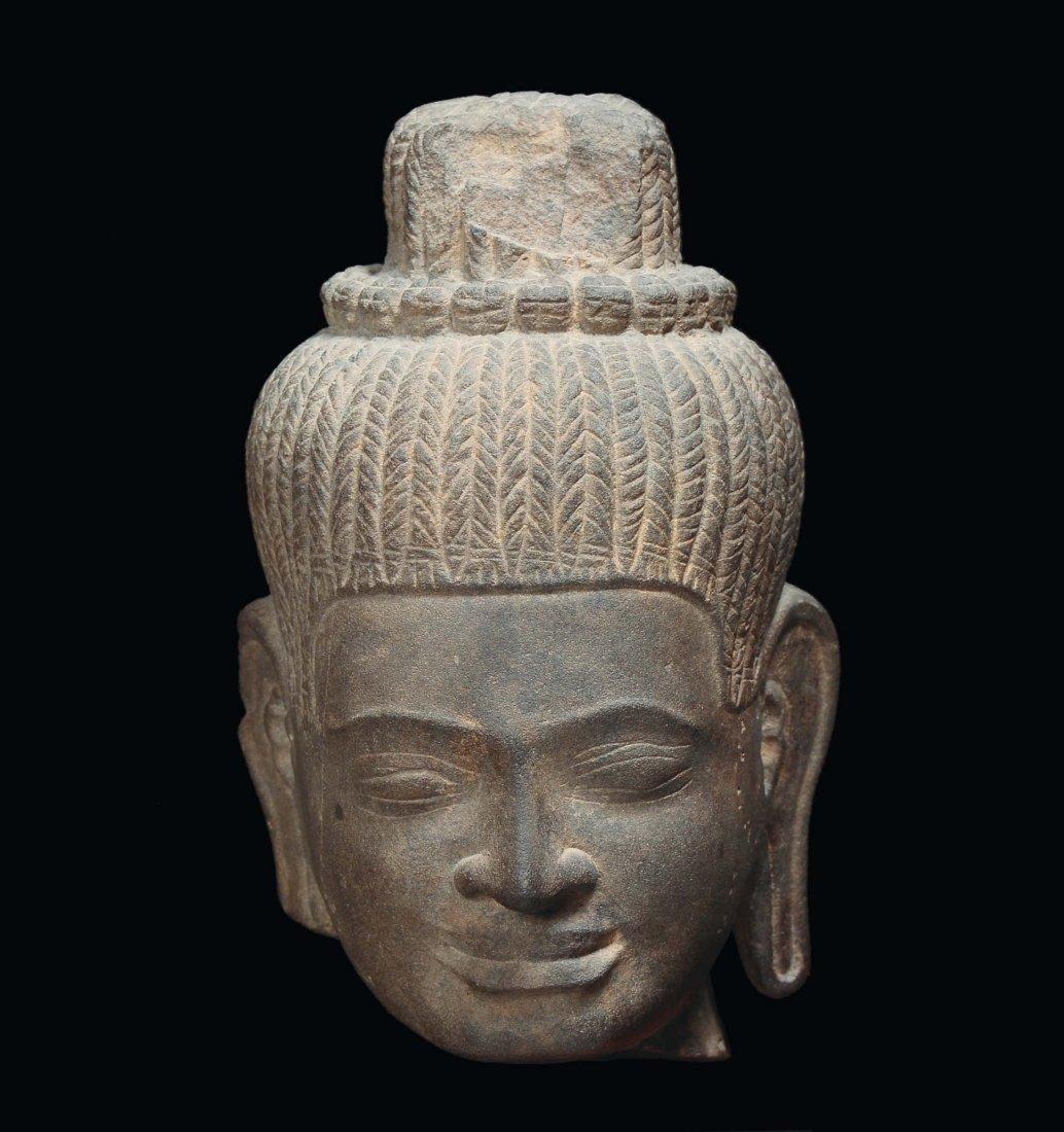 A Khmer stone head, Indochina, 12th century