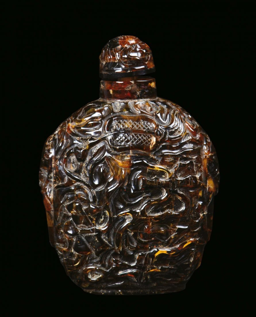 A relief amber snuff bottle, China 19th century