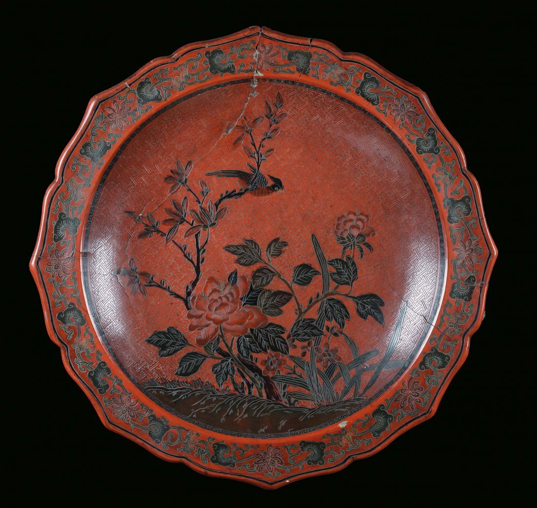 A large carved red lacquer plate, China, Ming Dynasty,