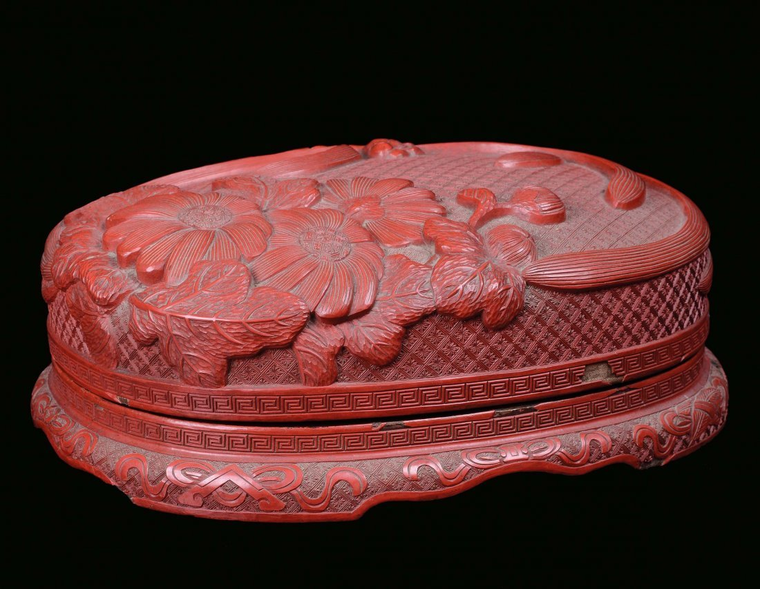 A red lacquer box with floral decoration, China, Qing D