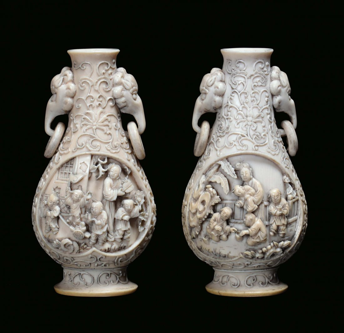 A pair of ivory vases with handles in the shape of elep