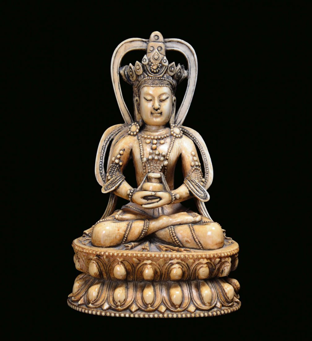 A small sculpture representing an ivory Bodhisattva on