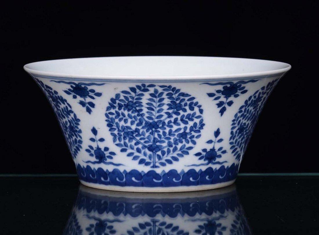 A small porcelain bowl with monochrome blue decoration,