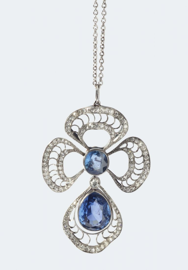 A 20th century pendent with two sapphire, old-cut