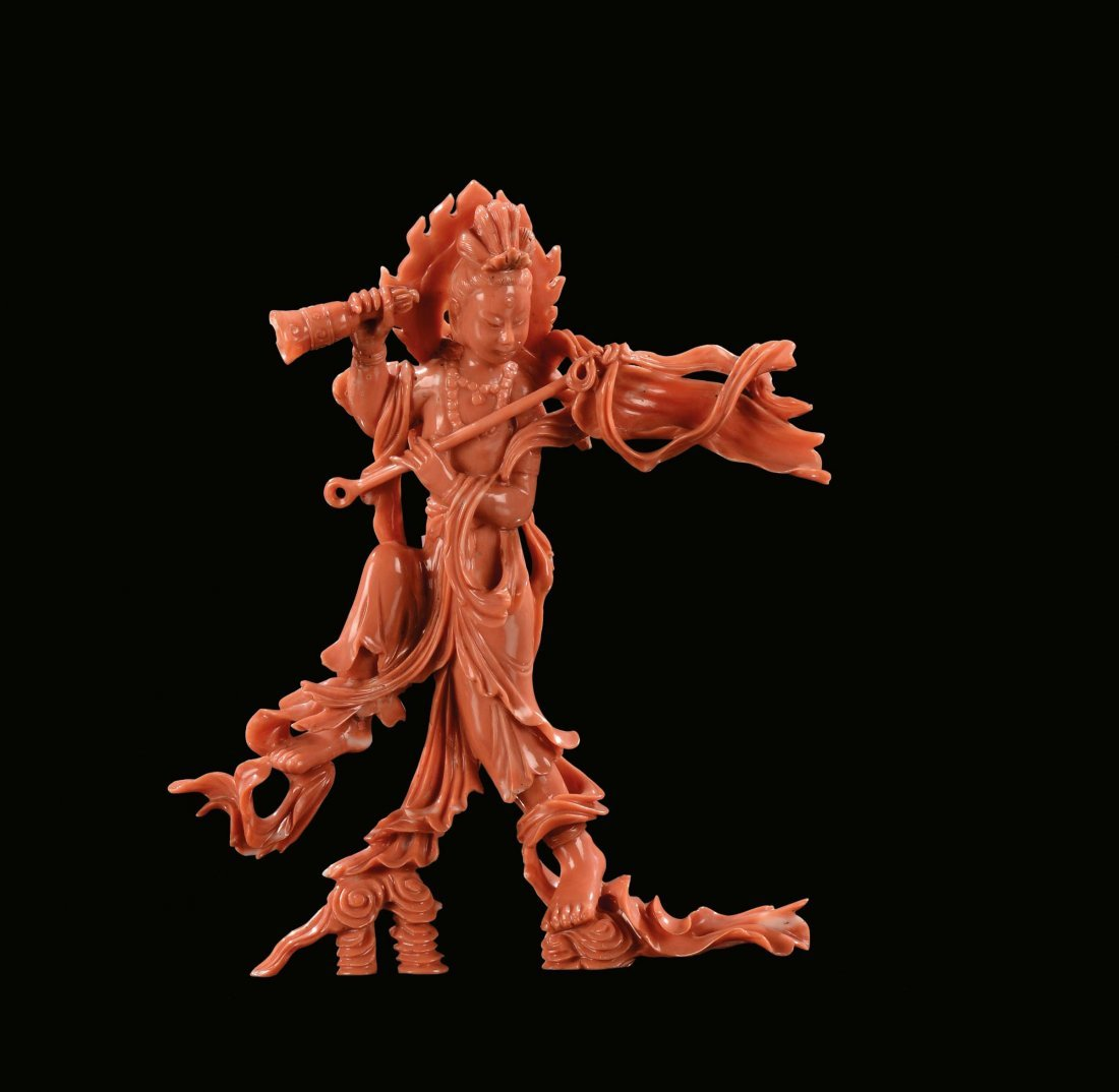 A coral figure of Guanyin with handbell, China, early