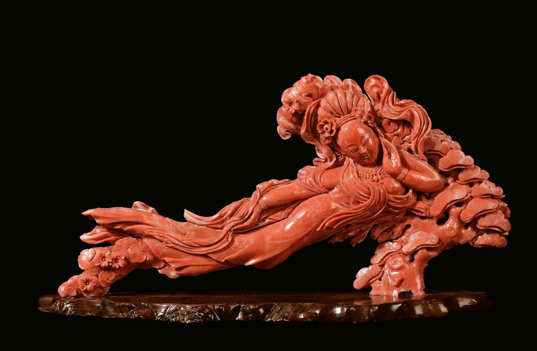 A carved coral figure of lying Guanyin, China, Qing